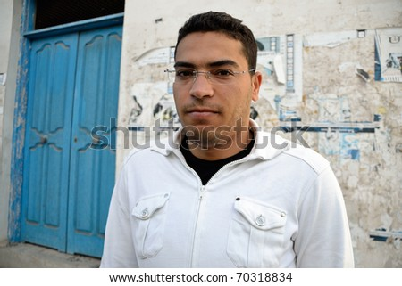 Angry tunisian man during violent protests on the street of Tunis. - stock photo