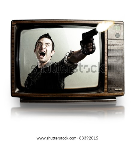 angry tv man shooting a gun, represents violence in tv programs and movies - stock photo