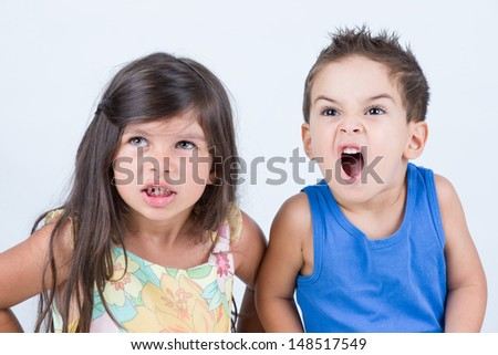 Angry two little kid with furious expression - stock photo