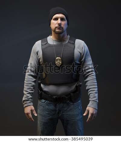 Angry Undercover Law Enforcement Special Agent with weapon. - stock photo