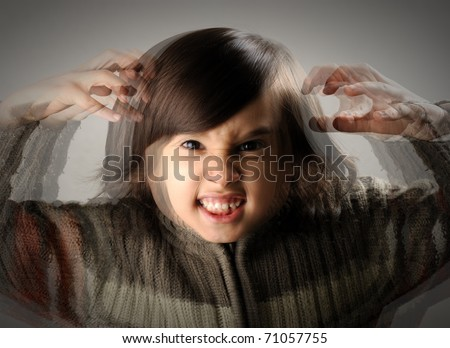 Angry upset child with long hair - stock photo