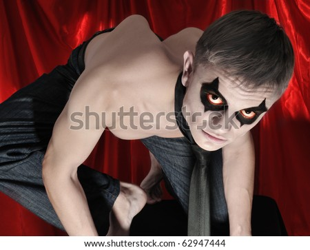 angry vampire in full alert looking at camera - stock photo