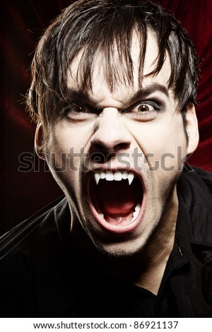 Angry vampire screaming - stock photo