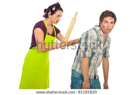 Angry wife beaut with a pin rolling her drunk unfaithful husband isolated on white background - stock photo