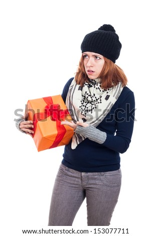 Angry winter woman holding present, isolated on white background. - stock photo