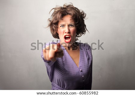 Angry woman accusing someone - stock photo