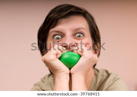angry woman bites ball - stock photo