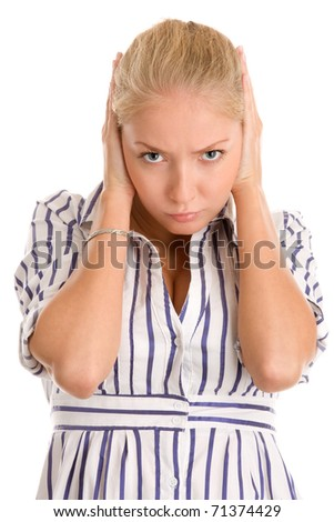 Angry woman covering ears with hands - stock photo