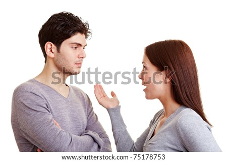 Angry woman discussing with her frustrated partner - stock photo