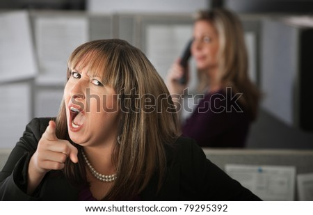 Angry woman employee pointing index finger - stock photo