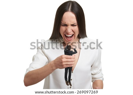angry woman holding in fist small scared man and yelling at him. isolated on white background - stock photo