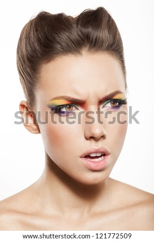 angry woman is screaming, beautiful female face with rainbow makeup. - stock photo