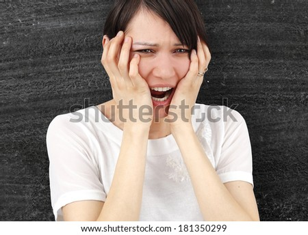 Angry woman isolated on black background - stock photo