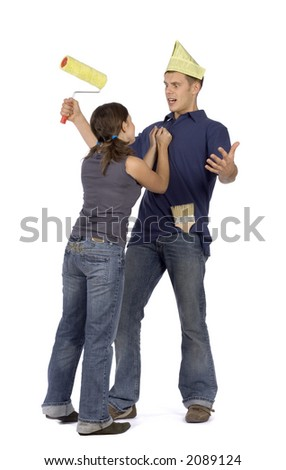 angry woman keeping painter's shirt - stock photo