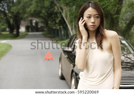 Angry woman on phone, broken car