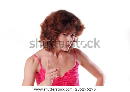 Angry woman portrait looking at camera and making threatening gestures - stock photo
