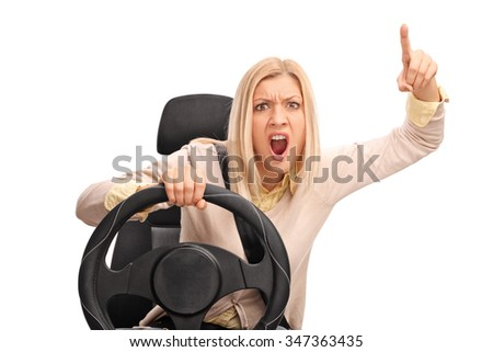 Angry woman pretending to drive and shouting towards the camera isolated on white background - stock photo
