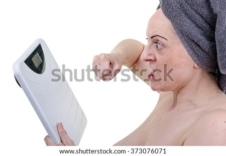 Angry woman punching bathroom weighing scales. White background. - stock photo