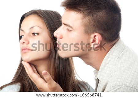 Angry woman rejects her boyfriend isolated on white. - stock photo