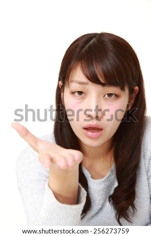 angry woman requests something - stock photo