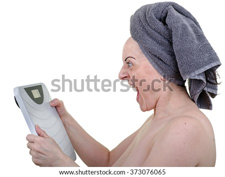 Angry woman screaming at bathroom weighing scales. White background. - stock photo