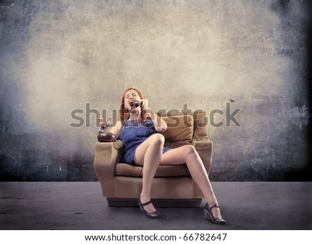 Angry woman screaming at telephone - stock photo