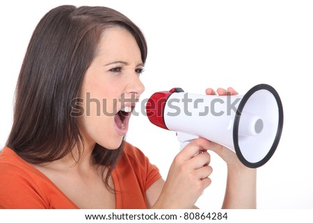 Angry woman screaming in speakerphone - stock photo