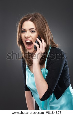 angry woman shouts in phone. Negative emotions on a face