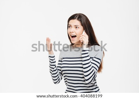 Angry woman talking on the phone isolated on a white background - stock photo