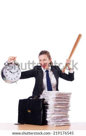Angry woman with baseball bat under stress missing deadline - stock photo