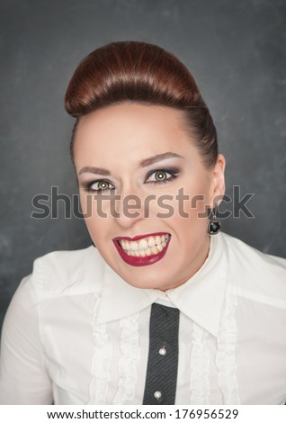 Angry woman with teeth grin  - stock photo