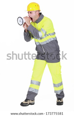 Angry worker with megaphone - stock photo