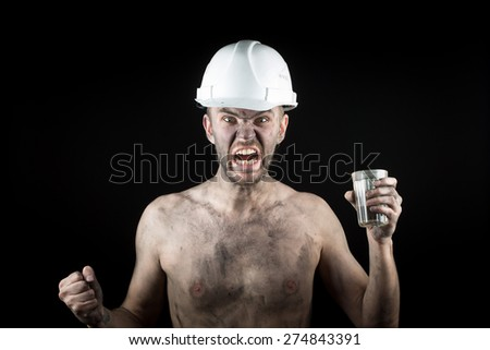 angry working in a dirty helmet - stock photo
