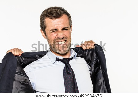 angry young bearded businessman grinding teeth for exasperation at work, opening up his suit for corporate suffocation, not breathing from frustration, isolated, white background