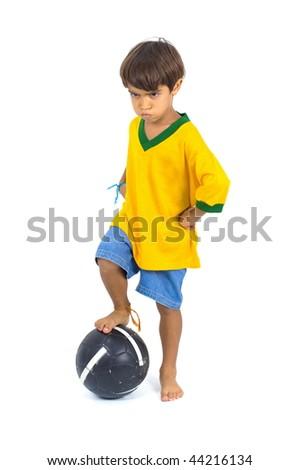 Angry young Brazilian Player and a ball . - stock photo