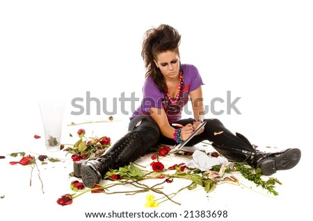 Angry young brunette woman with a vase of flowers shows how much love hurts - stock photo