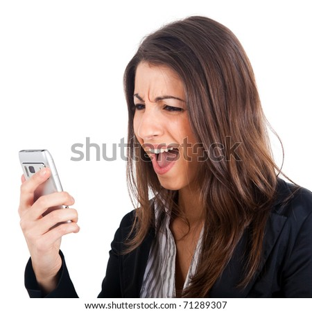 Angry young business woman yelling at her phone isolated over white. - stock photo