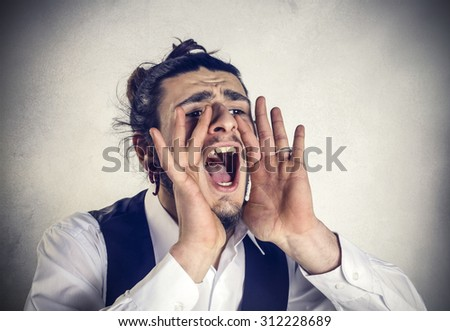 Angry young businessman screaming