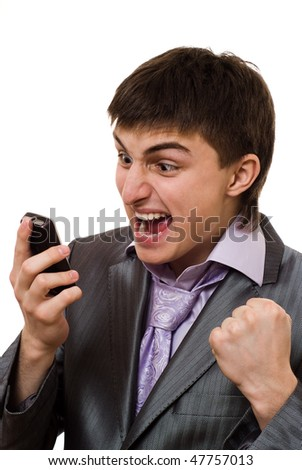 angry young businessman talking on the phone on a white background