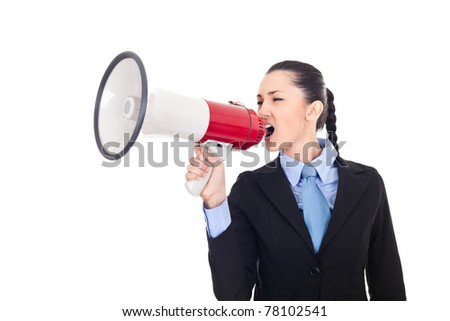 angry young businesswoman shouting into megaphone against white background - stock photo