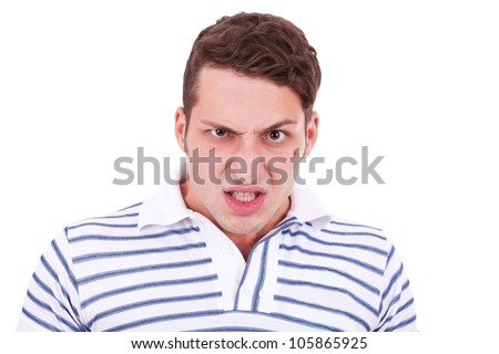 angry young casual man making a furious face on white background - stock photo