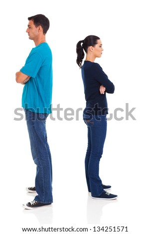 angry young couple isolated on white background - stock photo