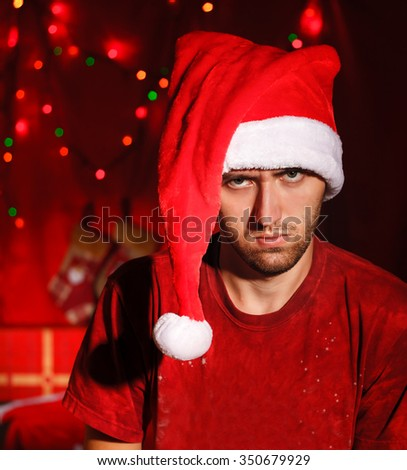 Angry young man at the Christmas background - stock photo