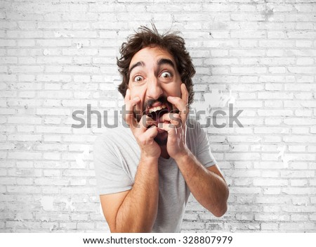 angry young man crazy pose - stock photo