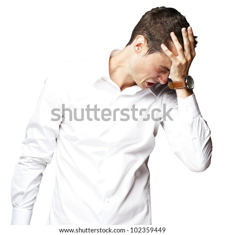 Angry young man doing a frustration gesture over a white background - stock photo