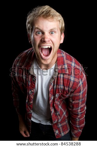 Angry young man screaming yelling