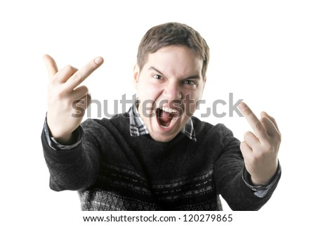 angry young man shows middle fingers isolated on white background. focus on hands - stock photo