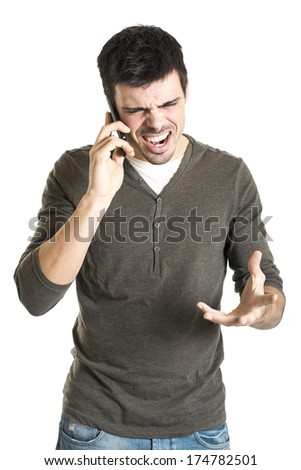Angry young man talking with cell phone isolated on a white background - stock photo