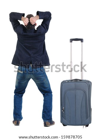 angry young man traveling with suitcas . Rear view. isolated over white.