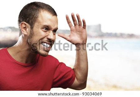 angry young man with a sea as a background - stock photo